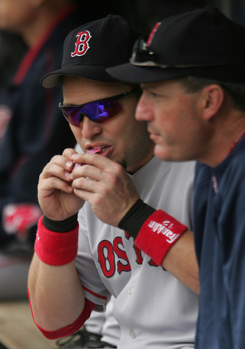 27 June 2007: Eric Hinske playse with his bubble gum in the dugout before the game. Seattle Mariners vs Boston Red Sox at Safeco Park in Seattle, Washington.