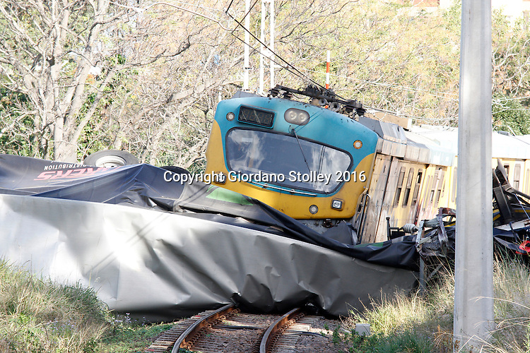 DURBAN - 17 June 2016 - A MetroRail commuter train ploughed into a lorry at a level crossing near the Mosely railway station in Queensburgh, Durban, Only 10 people, including the truck driver were lightly injured. Picture: Allied Picture Press/APP