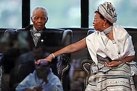 Graca Machel with her husband, former South African President Nelson Mandela, at the inauguration ceremony of Jacob Zuma in Pretoria. Zuma is the fourth democratically elected president of South Africa.