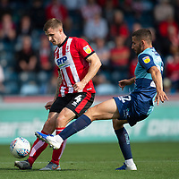 Lincoln City's Michael O'Connor battles with Wycombe Wanderers' Nick Freeman<br /> <br /> Photographer Andrew Vaughan/CameraSport<br /> <br /> The EFL Sky Bet League One - Wycombe Wanderers v Lincoln City - Saturday 7th September 2019 - Adams Park - Wycombe<br /> <br /> World Copyright © 2019 CameraSport. All rights reserved. 43 Linden Ave. Countesthorpe. Leicester. England. LE8 5PG - Tel: +44 (0) 116 277 4147 - admin@camerasport.com - www.camerasport.com