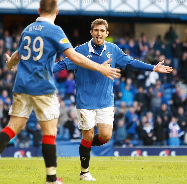 Nikica Jelavic celebrates his second goal with Gregg Wylde