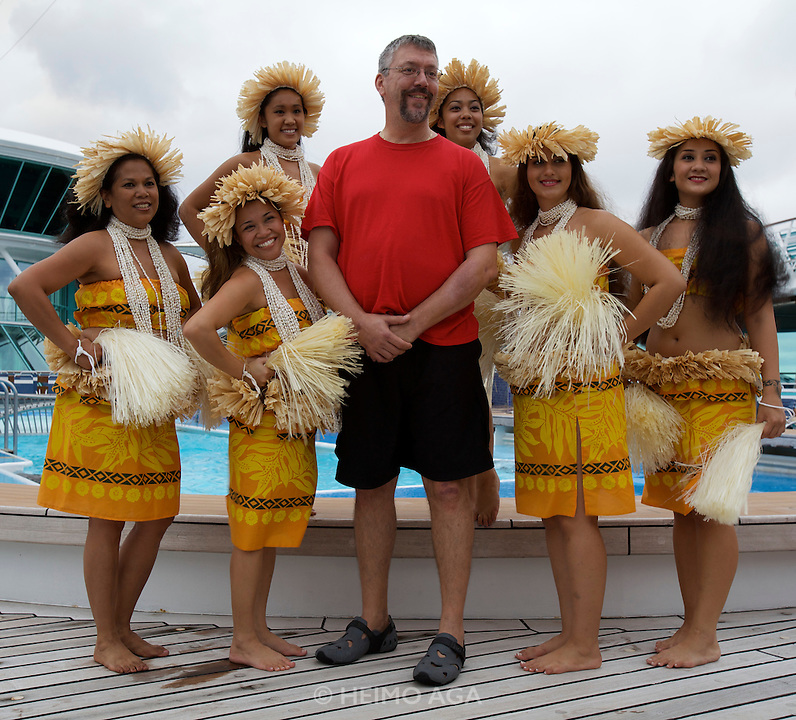 Aboard the Rhapsody of the Seas, on a cruise from Vancouver to Hawaii. Spirit of Polynesia Performance at the Pool Deck.