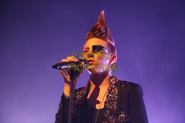 LA ROUX (Eleanor Jackson).Performing live at Shepherd's Bush Empire, London, England..November 26th, 2009.stage concert gig performance music half length black jacket embellished jewel encrusted collar hair mohawk make-up singing eye.CAP/MAR.© Martin Harris/Capital Pictures.
