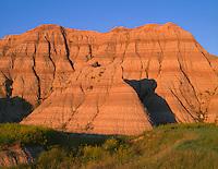 SDBD_004 - USA, South Dakota, Badlands National Park, Sunset light defines bands in eroded, sedimentary layers, North Unit.