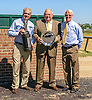 John Mooney receiving a trophy from Don Yovanovich and Duncan Patterson thanking him over 3 decades of service to the Amateur Riders Club of America at Delaware Park on 9/12/16