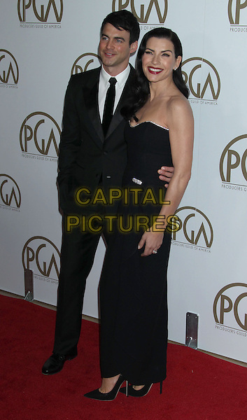 Keith Lieberthal & Julianna Margulies.At the 24th Annual Producers Guild Awards held at the Beverly Hilton Hotel, Beverly Hills, California, USA,.26th January 2013..PGAs PGA arrivals full length dress suit married husband wife black  strapless  .CAP/ADM/RE.©Russ Elliot/AdMedia/Capital Pictures.