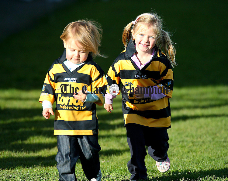 Tubber sisters 5 year old Ruby (right) and Cara (2) supporting their team at Gurteen.