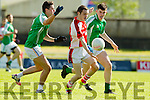 Trevor Wallace and Kieran Dwyer St Brendans in action against Dean Fitzgerald Rathmore in the  Kerry County Football Championship on Saturday.