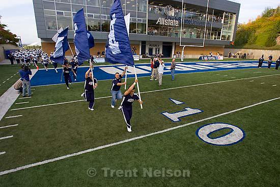 Logan - BYU vs. Utah State University (USU) college football Friday, October 3, 2008. byu cheerleaders with flags