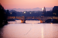 The River Po and Ponte Umberto I at sunset, Turin, Piedmont, Italy