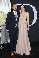 www.acepixs.com<br /> <br /> February 2 2017, LA<br /> <br /> Jamie Dornan and Dakota Johnson arriving at the premiere of 'Fifty Shades Darker' at The Theatre at The Ace Hotel on February 2, 2017 in Los Angeles, California.<br /> <br /> By Line: Peter West/ACE Pictures<br /> <br /> <br /> ACE Pictures Inc<br /> Tel: 6467670430<br /> Email: info@acepixs.com<br /> www.acepixs.com