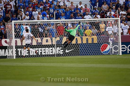 Sandy - USA goalkeeper Tim Howard leaps for the save, but the ball goes in. Goal by El Salvador midfielder Christian Castillo. USA vs. El Salvadar FIFA World Cup Qualifier Soccer Saturday, September 5 2009 at Rio Tinto Stadium. .