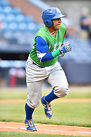 Lexington Legends catcher Meibrys Viloria (4) runs to first base during a game against the Asheville Tourists at McCormick Field on May 29, 2017 in Asheville, North Carolina. The Legends defeated the Tourists 5-2. (Tony Farlow/Four Seam Images)