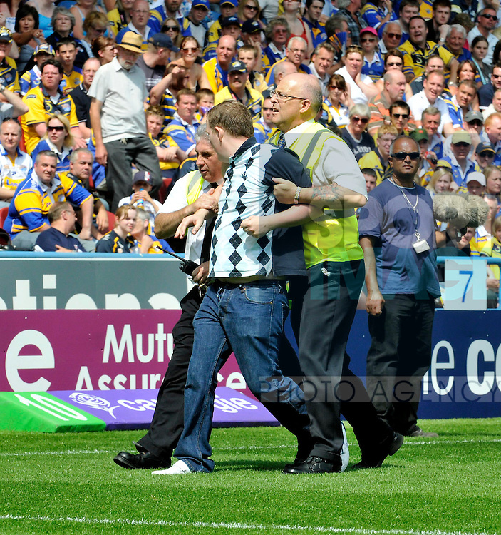 Stewards escort a pitch invader from the ground..Carnegie Challenge Cup SF..Leeds Rhinos v St Helens RFC..26th July, 2008..--------------------..Sportimage +44 7980659747..admin@sportimage.co.uk..http://www.sportimage.co.uk/