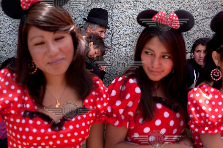 Girls dress up like Minnie Mouse for Carnival in Guanujo, near Guaranda.