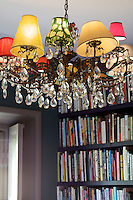 A detail of the 1950's crystal  chandelier in Paolo Bagnara's study - the lampshades are all different sizes, shapes and colours
