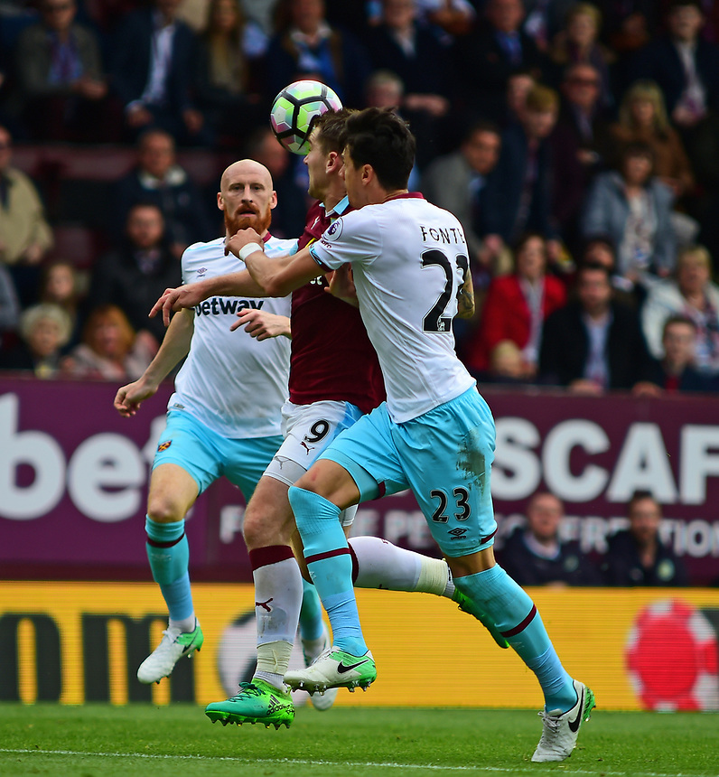 Burnley's Sam Vokes vies for possession with West Ham United's Jose Fonte<br /> <br /> Photographer Andrew Vaughan/CameraSport<br /> <br /> The Premier League - Burnley v West Ham United - Sunday 21st May 2017 - Turf Moor - Burnley<br /> <br /> World Copyright &copy; 2017 CameraSport. All rights reserved. 43 Linden Ave. Countesthorpe. Leicester. England. LE8 5PG - Tel: +44 (0) 116 277 4147 - admin@camerasport.com - www.camerasport.com