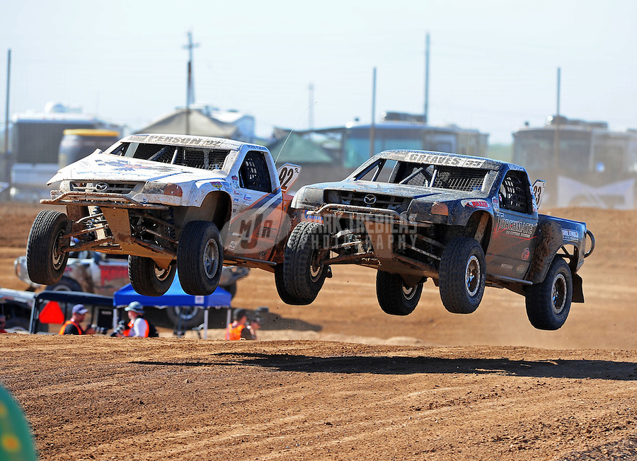 Apr 16, 2011; Surprise, AZ USA; LOORRS driver C.J. Greaves (33) races alongside Jacob Person (92) during round 3 at Speedworld Off Road Park. Mandatory Credit: Mark J. Rebilas-.