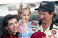 Dale Earnhardt celebrates his 4th Winston Cup championship with wife Teresa Earnhardt and daughter Taylor Earnhardt, Atlanta Journal 500, Atlanta Motor Speedway, Hampton, GA, November 18, 1990. (Photo by Brian Cleary/bcpix.com)
