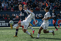 FOXBOROUGH, MA - MARCH 7: Mauricio Pineda #22 of Chicago Fire defends in an attack on goal by Adam Buksa #9 of New England Revolution during a game between Chicago Fire and New England Revolution at Gillette Stadium on March 7, 2020 in Foxborough, Massachusetts.