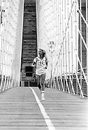 New York, New York USA, June 1979 - French singer Sylvie Vartan jogs across the Brooklyn Bridge. She recently released her first album in the US and was in New York City to promote it.