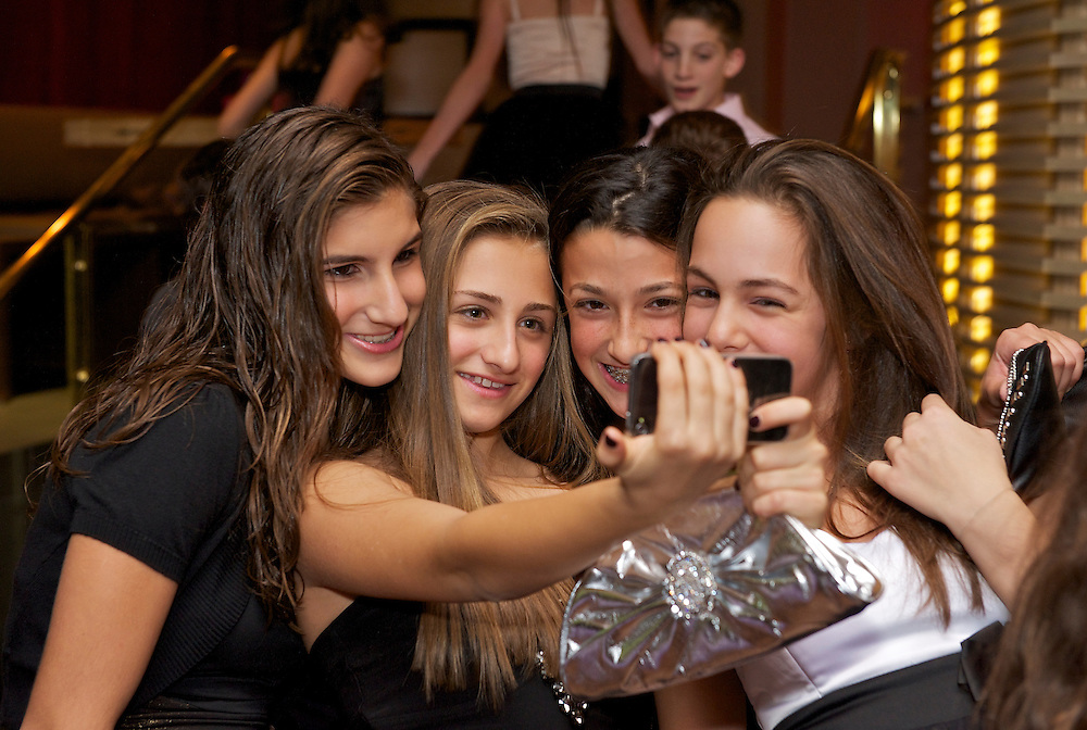 Girls taking a group selfie at the party.