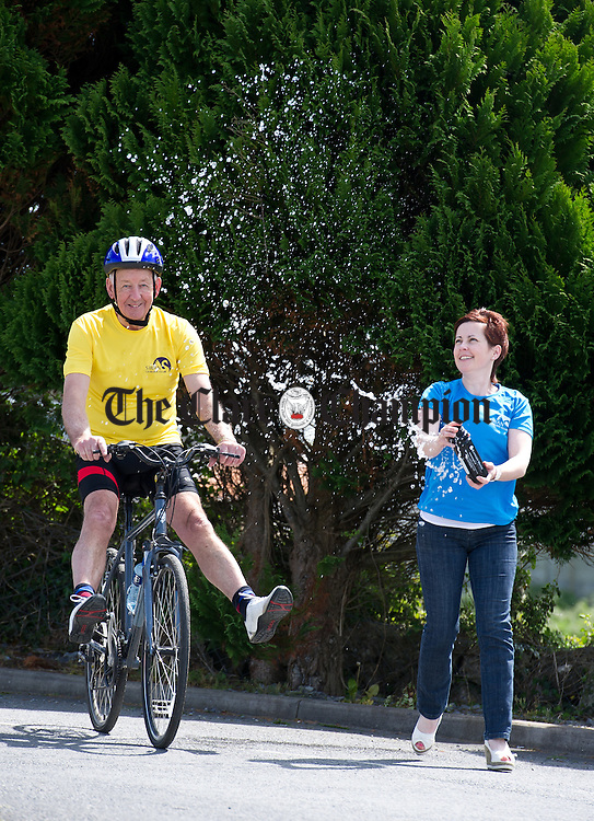 Olivia O Grady, manager of the Swan Leisure Club in the Lady Gregory Hotel, Gort, keeps one of her Swan Leisure Club team members Michael O Grady, hotel proprietor, cooled down during a training session for the forthcoming Lough Cutra Triathlon. Photograph by John Kelly.