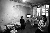 """Nagorny-Karabach, 12.05.2011, Shushi. Ein Neugeborenes liegt in T¸cher gewickelt auf dem Bett (l.), w?hrend Tante und Mutter im Raum sitzen. """"The Twentieth Spring"""" - ein Portrait der s¸dkaukasischen Stadt Schuschi, 20 Jahre nach der Eroberung der Stadt durch armenische K?mpfer 1992 im B¸gerkrieg um die Unabh?ngigkeit Nagorny-Karabachs (1991-1994). A new born Baby wrapped in a scarf (l.) with his aunt and mother.""""The Twentieth Spring"""" - A portrait of Shushi, a south caucasian town 20 years after its """"Liberation"""" by armenian fighters during the civil war for independence of Nagorny-Karabakh.(1991-1994)..Un bébé nouveau-né enveloppé dans un foulard (à gauche) avec sa tante et sa mère. """"Le Vingtieme Anniversaire"""" - Un portrait de Chouchi, une ville du Caucase du Sud 20 ans après sa «libération» par les combattants arméniens pendant la guerre civile pour l'indépendance du Haut-Karabakh (1991-1994).. © Timo Vogt/Est&Ost, NO MODEL RELEASE !!"""