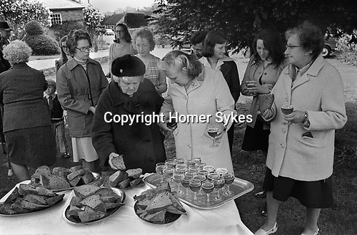 The Wicken Love Feast, takes place on Ascension Day and celebrates the joining together of two parishes in 1587. Wicken Northamptonshire 1970s Uk.  Open air service under the Gospel Oak.<br /> <br /> <br /> My ref 10a/13701/1976?