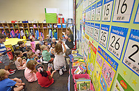 NWA Democrat-Gazette/BEN GOFF &bull; @NWABENGOFF<br /> Natalie Marts talks to her Kindergarten class on Monday Aug. 3, 2015 during the first day of school at R.E. Baker Elementary in Bentonville. Baker and Elm Tree elementary schools in Bentonville run on a nontraditional calendar.