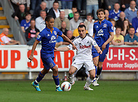 FAO SPORTS PICTURE DESK<br /> Pictured L-R: Steven Pienaar of Everton marked by Leon Britton of Swansea. Saturday, 24 March 2012<br /> Re: Premier League football, Swansea City FC v Everton at the Liberty Stadium, south Wales.