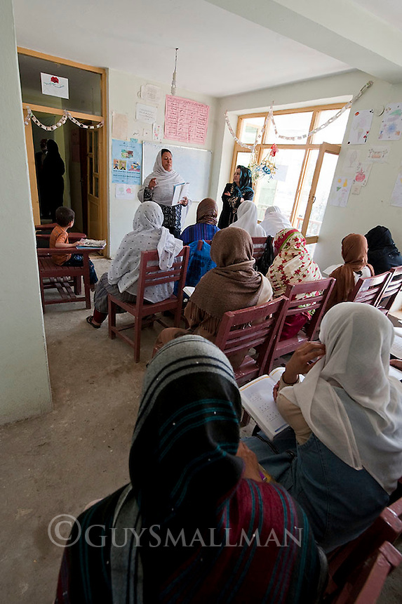 Afghan Women learn to read and write in a centre run by the Organisation of Promoting Afghan Women's Capabilities (OPAWC) in Kabul.