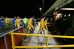 Airbus UK 4 Bangor City 1, 12/01/2007. The Airfield, Welsh Premier League. Dejected Bangor City players leave the field at the end of their match against lowly Airbus UK (blue) in a Welsh Premier League game at The Airfield, Broughton. The Wing Makers won by 4 goals to 1, having lead by a solitary goal at the break in this North Wales clash. Photo by Colin McPherson.