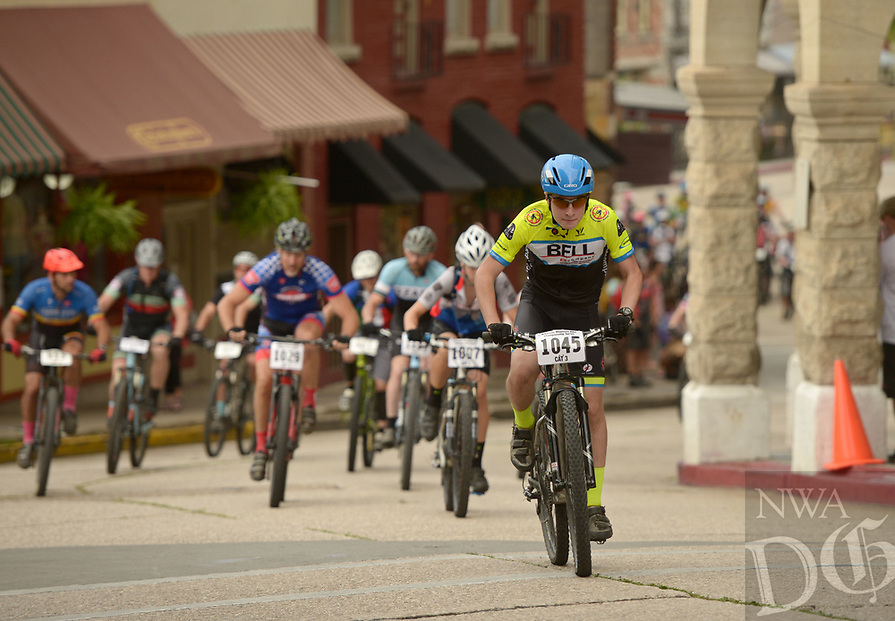 NWA Democrat-Gazette/BEN GOFF @NWABENGOFF<br /> Andrew Files (1045) of Little Rock leads his heat in the men's category 3 race off of the starting line Sunday, July 16, 2017, from Basin Park in downtown Eureka Springs before making their way onto the singletrack at Lake Leatherwood City Park during cross country races on the final day of the 19th annual Fat Tire Festival.