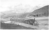 RGS K-27 #461 with a southbound 7-car freight departing Lizard Head Pass.  Stock cars may be seen on the wye in the background.<br /> RGS  Lizard Head Pass, CO  Taken by Perry, Otto C. - 10/4/1947