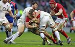 Alex Corbisiero and Chris Robshaw stop Dan Lydiate..RBS 6 Nations 2012.England v Wales.Twickenham.25.02.12.Credit: STEVE POPE - Sportingwales