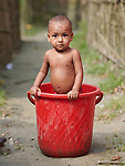 Jannathi Begum bathes in a bucket in West Fasura, a village on an island in the Brahmaputra River in northern Bangladesh. <br /> <br /> Parental consent obtained.