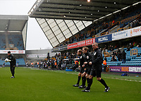 9th February 2020; The Den, London, England; English Championship Football, Millwall versus West Bromwich Albion; Referees warming up during Storm Ciara - Strictly Editorial Use Only. No use with unauthorized audio, video, data, fixture lists, club/league logos or 'live' services. Online in-match use limited to 120 images, no video emulation. No use in betting, games or single club/league/player publications