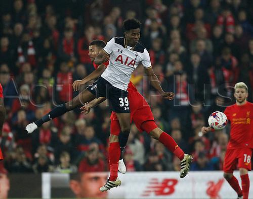 25.10.2016. Anfield, Liverpool, England. EFL Cup. Liverpool versus Tottenham Hotspur. Tottenham's Shayon Harrison wins an aerial battle against Liverpool midfielder Kevin Stewart.