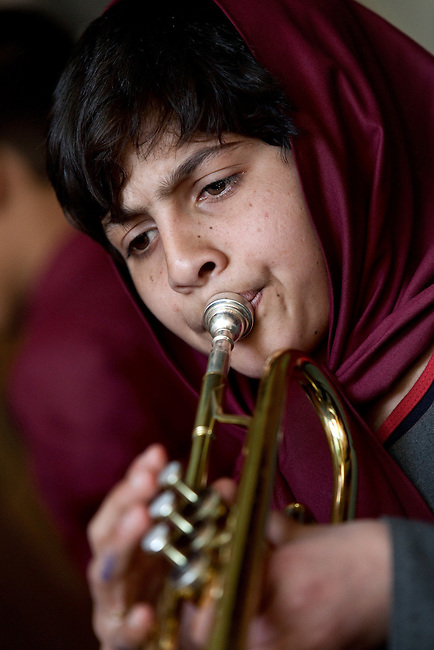 18 May 2012, Kabul Afghanistan: Orphan student Khalida Safai (10) practises trumpet during a lesson at the National Institute of Music. Dr Ahmad Nasir Sarmast founded the Afghanistan National Institute of Music in Kabul that takes in students from all walks of Afghan life to educate them in musical studies. The World Bank is supporting this legacy by providing funding for a new concert hall and to gather additional land to expand the premises. Many of the students are orphans who would otherwise have no opportunity or access to the knowledge or instruments that the Institute has gathered. Up to half a dozen ex-patriate music  teachers run classes in music that ranges from traditional Afghan and classical  music to modern rock.  Picture by Graham Crouch/World Bank