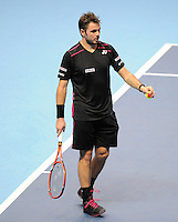 Stan Wawrinka (SUI) picks up a piece of confetti that fell from the ceiling and hands it to a ball boy during Day Two of the Barclays ATP World Tour Finals 2015 played at The O2, London on November 16th 2015