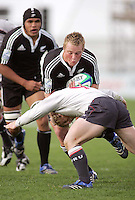 New Zealand flanker Luke Baird runs into Welsh scrum half Gareth Williams during the Division A semi-final at Ravenhill. Result New Zealand 36 Wales 12.