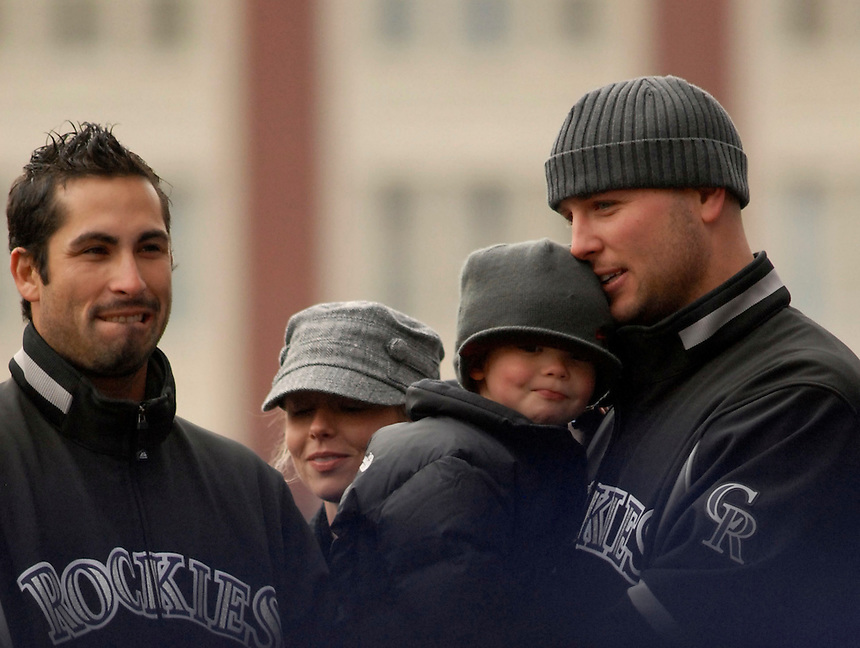 Colorado Rockies players Matt Holliday, right, Ryan Spilborghs, and Matt Holliday's son Jackson in downtown Denver during an event to celebrate the team's 2007 season.