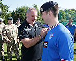 Rangers army visit in Germany - Ally McCoist autographs a soldier's Rangers top
