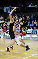 Syria's Anthouny Bakar drives past New Zealand's Jordan Ngatai during the FIBA World Cup Asia qualifier between the New Zealand Tall Blacks and Syria at TSB Bank Arena in Wellington, New Zealand on Sunday, 2 December 2018. Photo: Dave Lintott / lintottphoto.co.nz