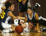 TORRINGTON, CT, 01/04/08- 010408BZ07- Kennedy's Jaleesa Roy (25), left,  and Breana Morrison (11) right, scramble for the ball with Torrington's Erika Murphy (15) during their game at Torrington High School Friday night.<br /> Jamison C. Bazinet Republican-American