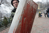 A shield stolen to a Berkut riot policemen is covered in blood.   Kiev, Ukraine