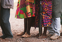 Footwear was a luxury as well as clean water to bdrink and bathe in Rwanda in 1994. Rwandans wait in line at the AmeriCares clinic in Buranga, Rwanda, Oct., 1994. The New Canaan, Conn., organization operated a clinic  from Aug., to Dec., 1994 halfway between the capitol, Kigali and the refugee camps in Goma, Zaire (now Congo). The treated refugees on their way home as well as people living in the area suffering from ailments resulting from unclean living conditions as well as conflicts with neighbors and occasional discovery of unused ordinance littering the countryside.  The living conditions resulted from the destruction of the country's infrastructures in the genocide and civil war in 1994.
