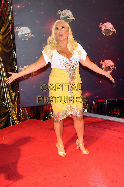 Vanessa Feltz<br /> The red carpet launch for 'Strictly Come Dancing' at Elstree Studios, Borehamwood, England.<br /> September 3rd, 2013<br /> full length gold white yellow top skirt dress hands arms mouth open funny <br /> CAP/CJ<br /> &copy;Chris Joseph/Capital Pictures