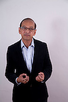 Deepak Jaykar who is a Feng Shui author, colunmist, interior designer has headshots done with Carlos Taylhardat of Art of Headshotsstudio in Olympic village false creek avncouver bc.